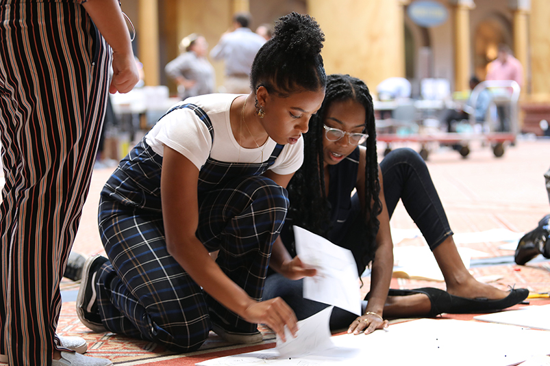 students review rules during design competition